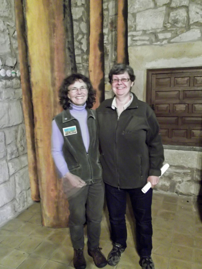Claire with Swedish forest pathologist Elna Stenström in front of her exhibit at IUFRO 2011 in Montesclaros, Spain