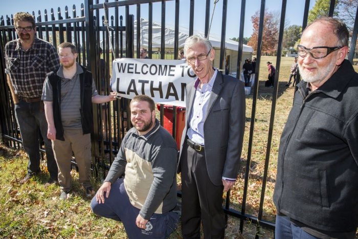 Residents of PI Latham are welcomed to the Latham Community by John a local resident
