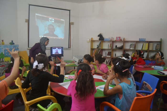 An online storytelling session in a library in Gaza