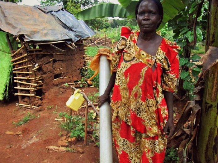 Catherine Nabuuso (66) in front of her latrine in her garden. (Picture: Susanne Muwazi/ARUWE)